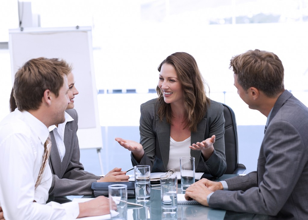 Attractive businesswoman laughing with her team during a meeting